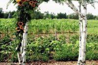 a cool birch wedding arch for a fall wedding