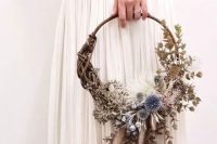a woodland hoop wedding bouquet with lots of greenery, white blooms, allium and fluffy touches is a lovely idea