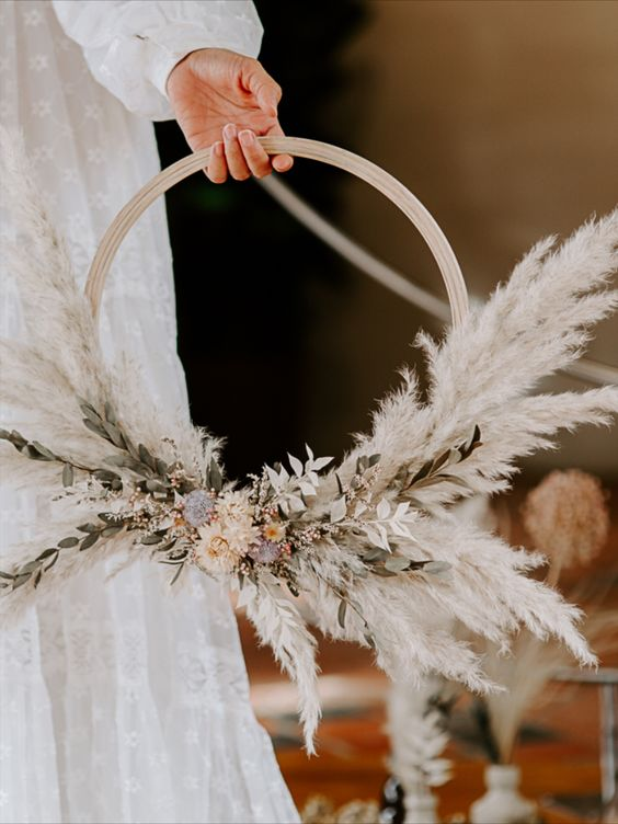 an adorable boho hoop wedding bouquet with pampas grass, dried blooms and leaves is a chic and cool idea to rock