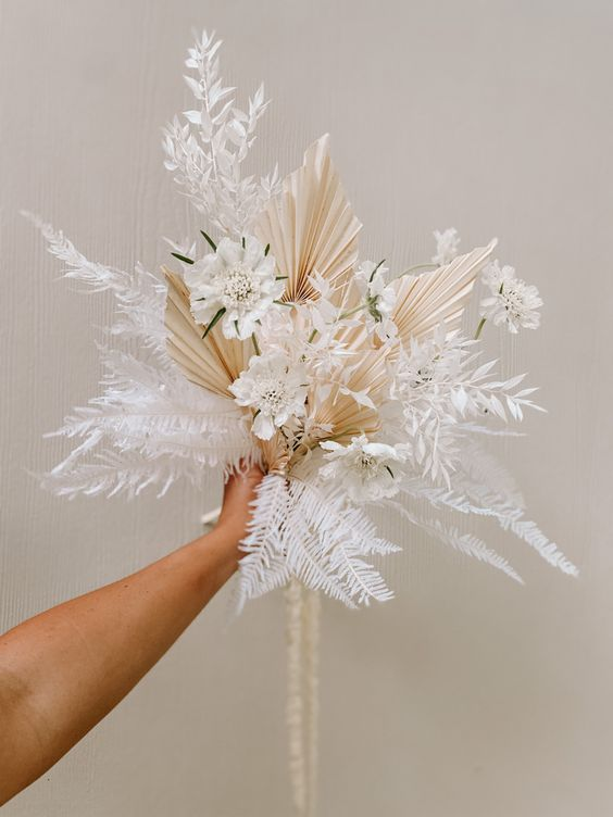 an ethereal dried wedding bouquet with ferns, fronds, white blooms and dried grasses is a fantastic idea for a spring wedding