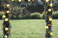 an outdoor wedding arch beautifully decorated with sunflowers, eucalyptus, hydrangea and roses is a pretty rustic wedding idea