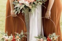 elegant hoop wedding bouquets with eucalyptus, white, blush and rust blooms are amazing and bright for a fall wedding
