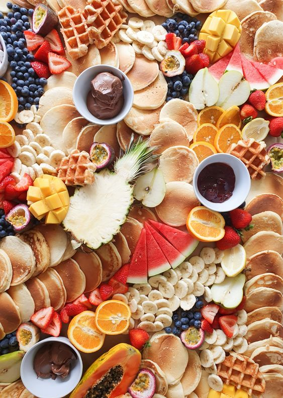 a lovely pancake platter with chocolate, fruits and berries and lots of pancakes is a gorgeous idea for a brunch wedding