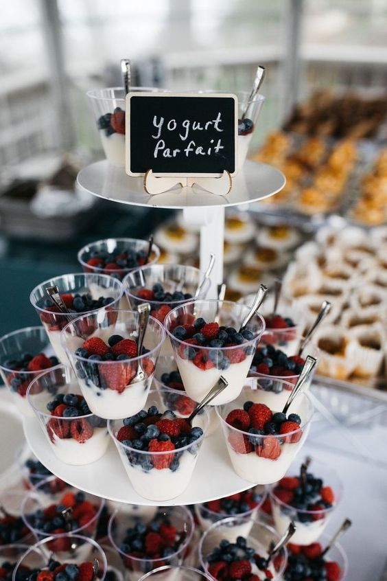 a parfait stand is a gorgeous idea for a modern brunch wedding, serve fresh yogurt with fresh berries and amek everyone happy