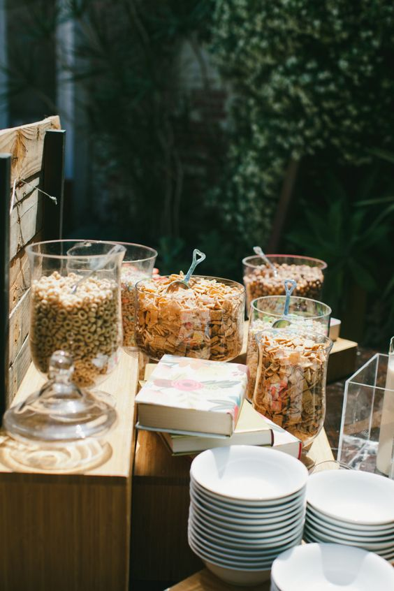a perfect cereal wedding station with lots of types of cereal and bowls, some ilk and toppings is a gorgeous idea