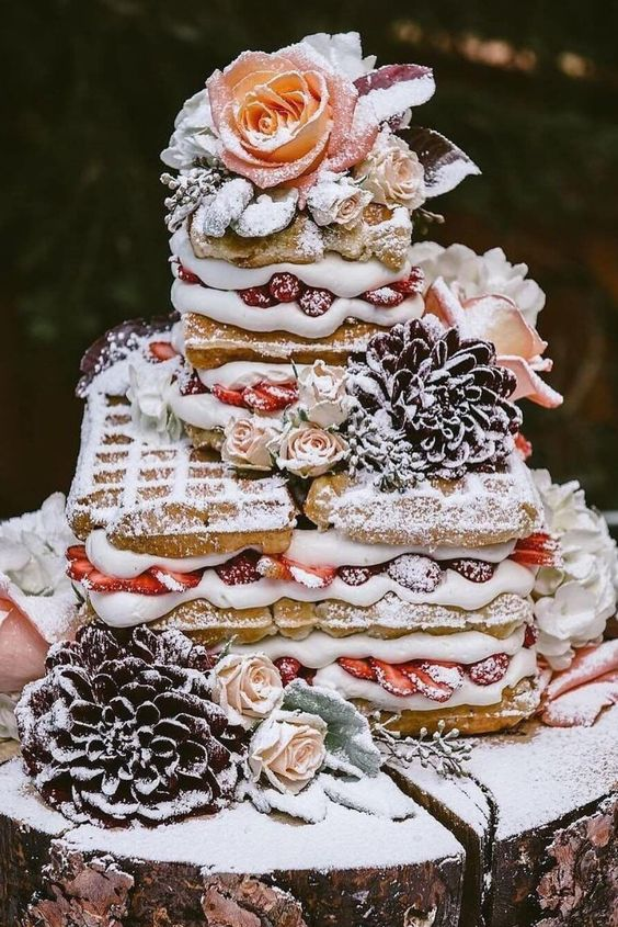 a waffle wedding cake with fresh berries and fresh blooms on top is ideal for a brunch wedding
