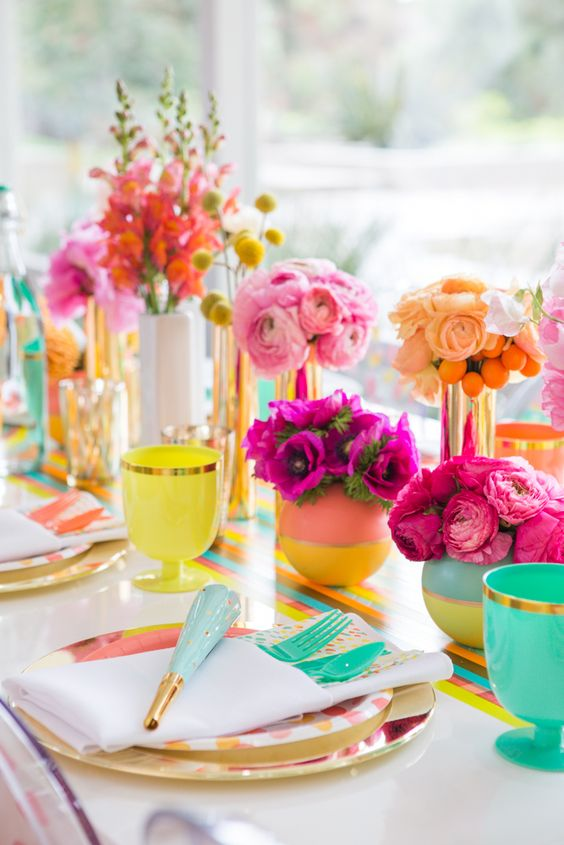 a bold bridal shower tablescape with a colorful runner, bold plates, glasses, color block vases and colorful blooms is a gorgeous idea to rock