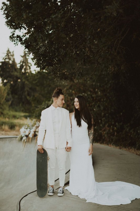 a classy white plain halter neckline A-line wedding dress with a long train and an open back is a perfect solution for a modern wedding