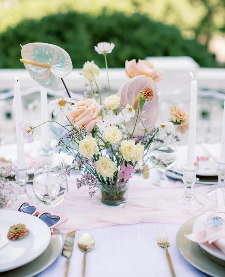 a cool tablescape with a blush table runner