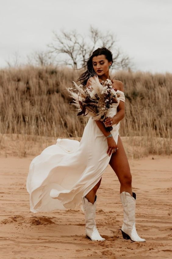 a lovely modern off the shoulder midi wedding dress with white cowboy boots is a cool solution for a bold boho bride