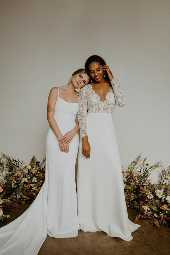 a lovely trumpet plain wedding dress on spaghetti straps and with a long train is a cool idea for a modern or minimalist bride