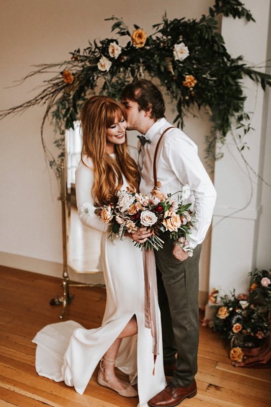 a modern plain flare wedding dress with a high neckline, long sleeves and a train plus a side slit is a lovely idea for a modern bride
