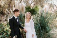 a pretty plain A-line wedding dress with a square neckline and puff sleeves, a train and a capelet is amazing for a modern bride