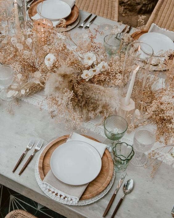 a very lush yet delicate wedding centerpiece of dried blooms, pampas grass, berries is a lovely idea for an organic wedding in spring or summer