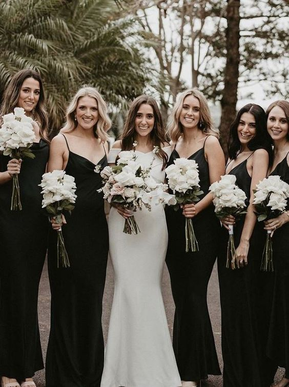 black slip maxi bridesmaid dresses with V-necklines are amazing for a bold fall or winter wedding