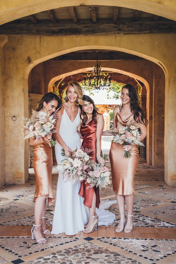 chic gold and rust knee and midi slip bridesmaid dresses and nude heels for a refined and cool fall wedding