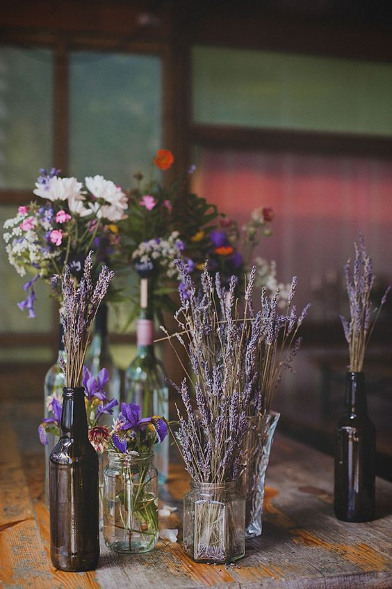 lavender in jars are always a good idea, it works for less formal weddings and gives a relaxed summer feel to any wedding reception space