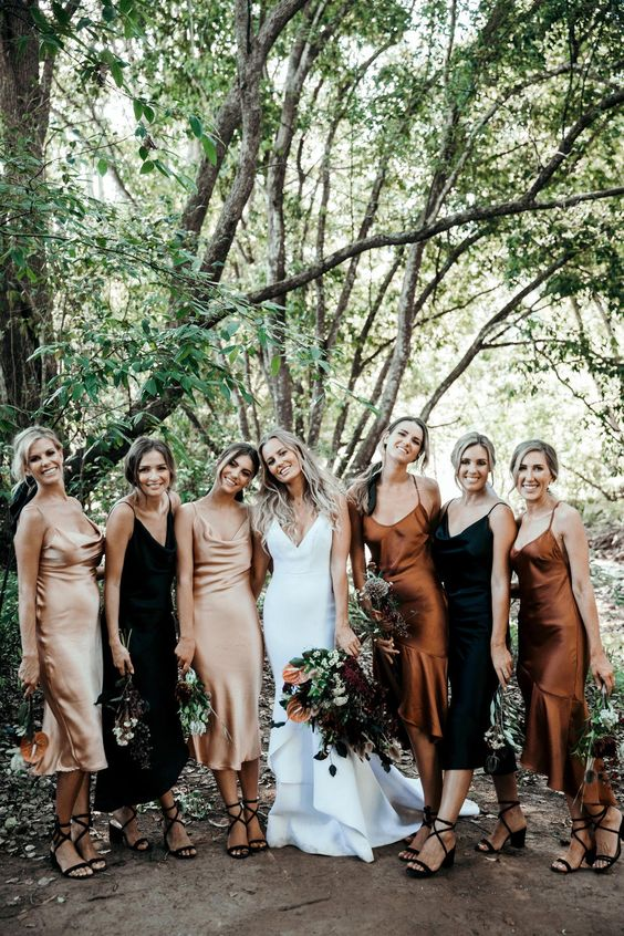 lovely blush, rust and black slip midi bridesmaid dresses and black lace up heels for a boho fall bridesmaid dress