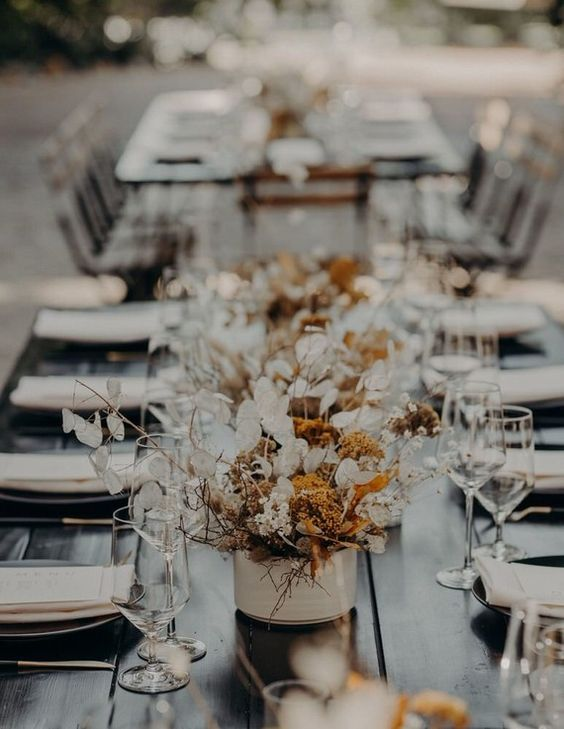 lovely dried flower wedding centerpieces with lunaria, dried blooms in mustard and rust colors and some twigs is a lovely idea for a fall wedding
