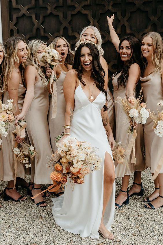 lovely grey slip midi bridesmaid dresses with cowl necks and black heels for a cool spring or fall wedding