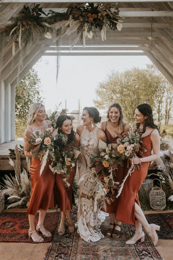 matching rust-colored midi bridesmaid dresses and nude shoes are a timeless idea for a fall or summer boho wedding