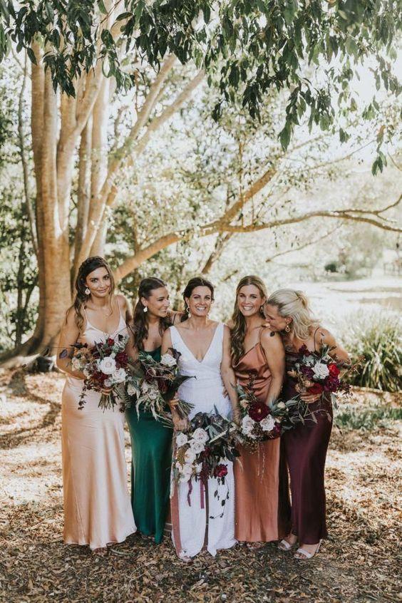 pretty mismatching slip maxi bridesmaid dresses in rust, deep purple, neutral, emerald are a trendy idea to rock