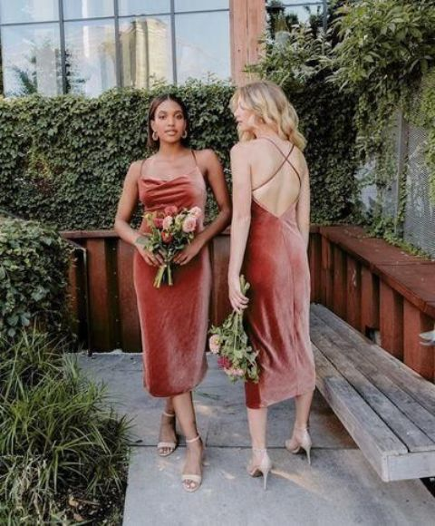 rust-colored midi spaghetti strap bridesmaid dresses with criss cross backs are chic for a bright fall wedding