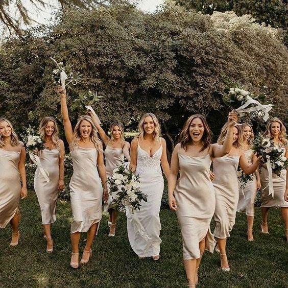 silver slip midi bridesmaid dresses with side slits and cowl necks, nude shoes for a cool summer or spring wedding
