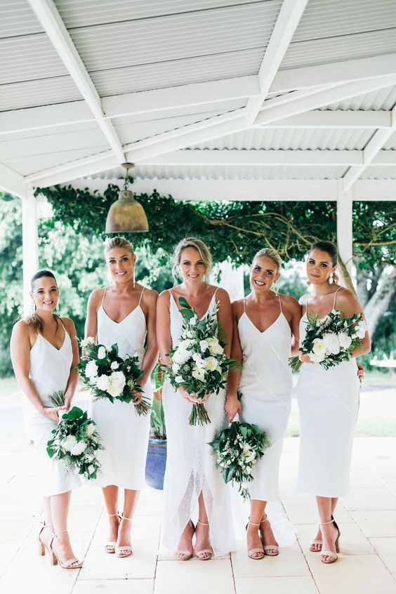 white slip midi bridesmaid dresses plus nude shoes are a cool and chic combo and the gals won't overheat in such flowy dresses