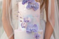 02 a beautiful iridescent wedding cake with purple orchids is a very refined, bold and chic idea for an iridescent wedding