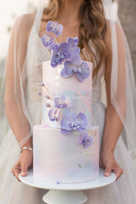 a beautiful iridescent wedding cake with purple orchids is a very refined, bold and chic idea for an iridescent wedding