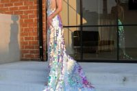 03 a breathtaking iridescent mermaid wedding dress with a long train and an open back plus iridescent hair to match