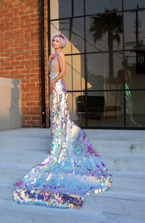 a breathtaking iridescent mermaid wedding dress with a long train and an open back plus iridescent hair to match