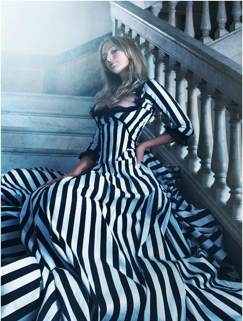 a striped Tim Burton inspired wedding dress with a deep cut is a very creative idea for such a  themed wedding is a bold solution to rock