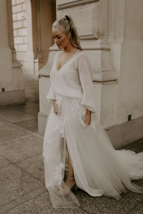 a casual neutral bridal look with a semi sheer jumper over a top and a tulle and lace A line skirt with a slit
