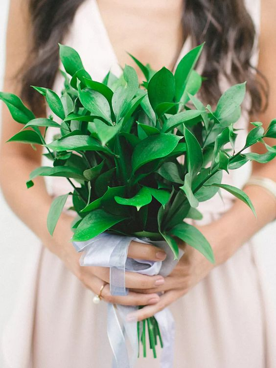 a pretty and simple greenery wedding bouquet with a cute ribbon bow looks very cool and very fresh