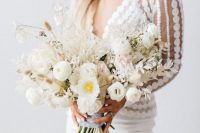 05 a stylish minimalist bridal look with a polka dot top and a plain pencil skirt plus a lush white flower wedding bouquet