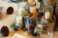 06 a classic woodland wedding centerpiece of tree stumps with moss, candles is a lovely solution for a rustic, cabin or just woodland celebration