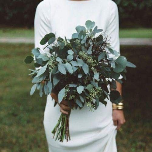 a simple and stylish eucalyptus wedding bouquet is a great idea for a modern or minimalist bride and it will refresh the look