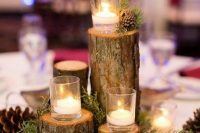 07 a classy woodland wedding centerpiece of tree stumps with floating candles, greenery and pinecones is a cozy solution for a winter or fall wedding