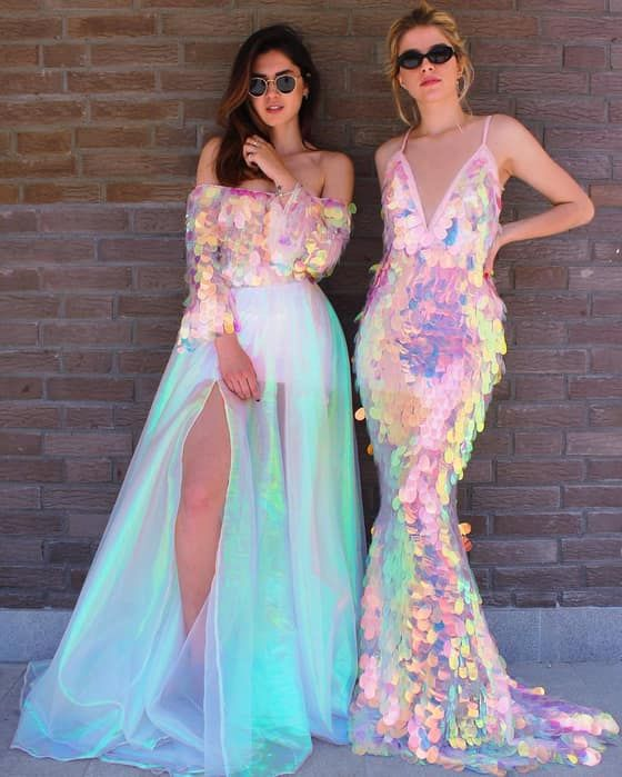 a fully iridescent mermaid wedding dress with a plunging neckline and an iridescent off the shoulder top plus an iridescent tulle skirt with a slit