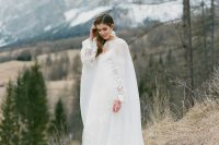 09 a jaw-dropping refined winter bridal look with an off the shoulder petal wedding dress, a sheer capelet and matching earrings