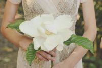 09 a large magnolia with leaves is a nice idea for a single stem wedding bouquet, whatever the bridal style is