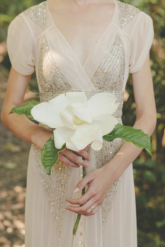 a large magnolia with leaves is a nice idea for a single stem wedding bouquet, whatever the bridal style is