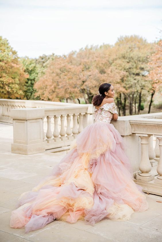 an iridescent wedding dress with purple and peachy touches and a shiny off the shoulder bodice is a beautiful solution