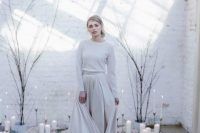 10 a white cashmere jumper plus an off-white A-line skirt with a train for a minimalist winter bride