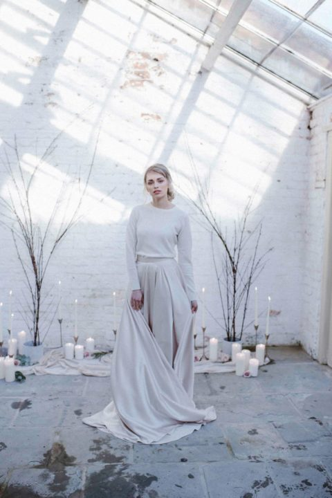 a white cashmere jumper plus an off white A line skirt with a train for a minimalist winter bride