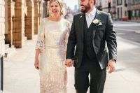 10 an iridescent wedding dress with a catchy spots on the skirt, with flare sleeves and a high necklace is gorgeous