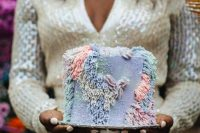 12 a jaw-dropping iridescent wedding cake with pastel fringe and holographic embellishments is a lovely idea for a bright wedding