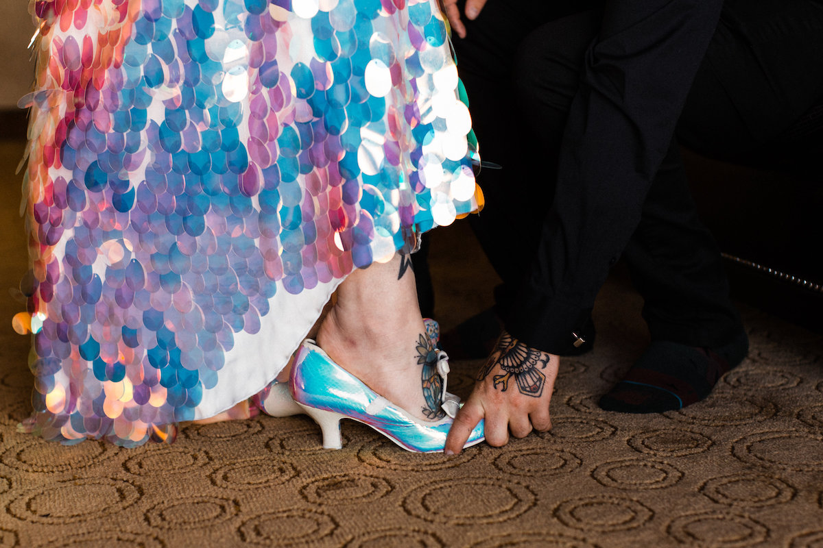 an iridescent wedding dress paired up with matching iridescent wedding shoes for a super bold and outstanding bridal look